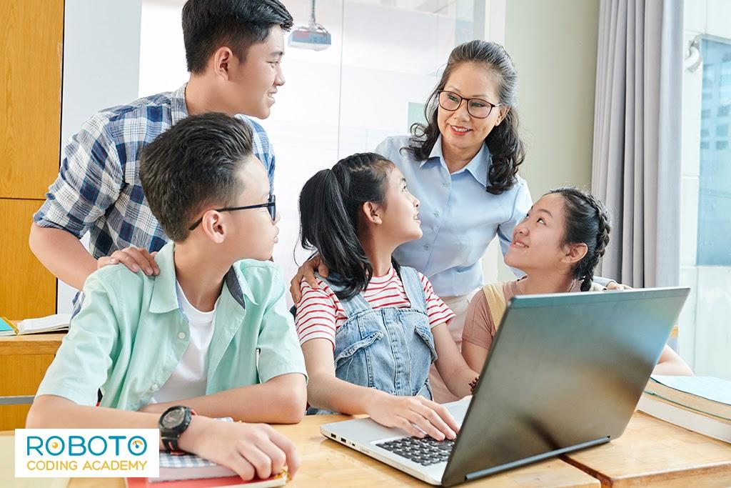 Alt Text: Kids In Coding Classes